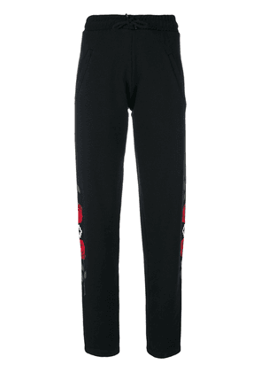 Marcelo Burlon County Of Milan rose print track pants - Black