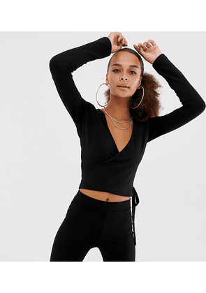 4ea0a7d8154 COLLUSION Petite elastic cut out long sleeve top | MILANSTYLE.COM
