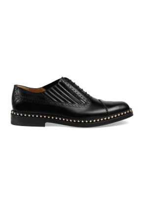 Leather lace-up with star trim