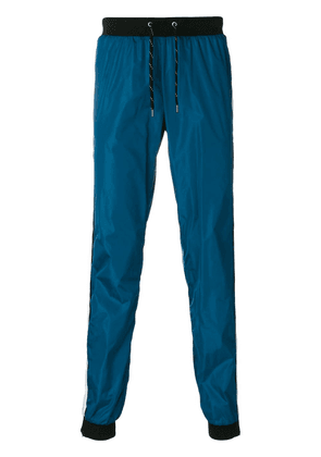 Andrea Crews side-stripe track trousers - Blue