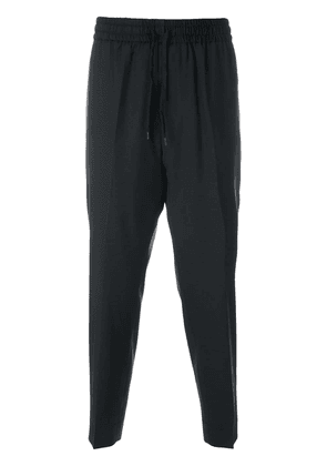 Études cropped tapered trousers - Black
