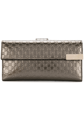 Gucci logo embossed wallet - Metallic