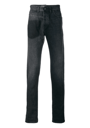 Diesel Black Gold deconstructed tapered jeans
