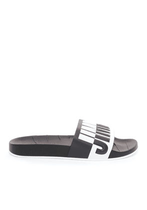 REY/M Black and White Logo Embossed Leather and Rubber Sliders