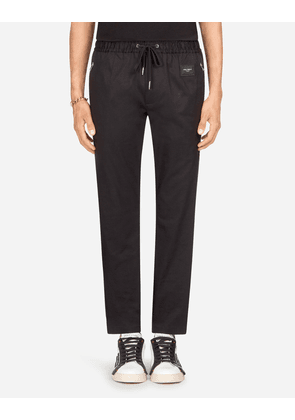 Dolce & Gabbana Trousers - JOGGING PANTS IN STRETCH COTTON WITH LOGO PLATE BLACK