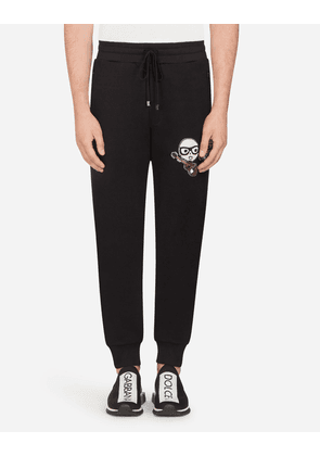 Dolce & Gabbana Trousers - COTTON JOGGING PANTS WITH DESIGNERS' PATCHES BLACK