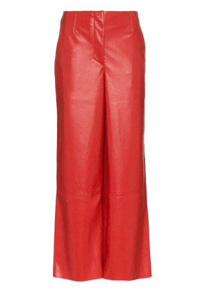 Nanushka high-waist flared vegan leather trousers