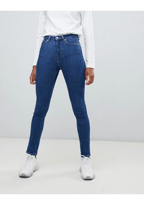 Weekday Thursday high waist skinny jeans with organic cotton in mid blue