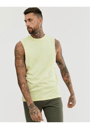 ASOS DESIGN organic relaxed sleeveless t-shirt with dropped armhole in yellow