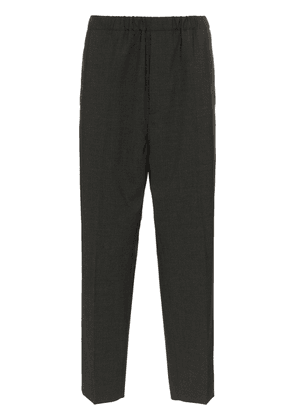 Jil Sander tailored and elasticated cropped trousers - Grey