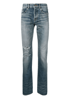 Saint Laurent ripped stonewashed high rise jeans - Blue