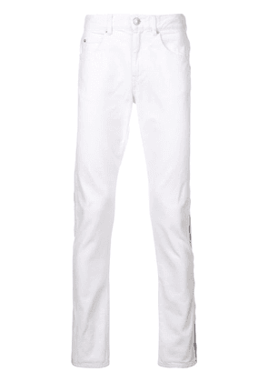 Isabel Marant side-stripe fitted jeans - White