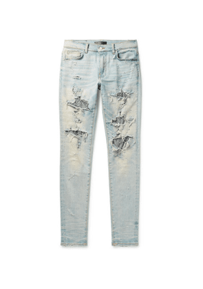 AMIRI - Skinny-fit Sequin-embellished Distressed Stretch-denim Jeans - Light blue