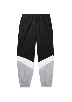 Vetements - Tapered Panelled Coated-cotton Sweatpants - Black