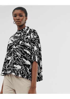 Weekday short sleeve blouse in black/white forest print