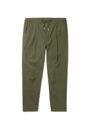 Moncler - Tapered Pleated Stretch-cotton Drawstring Trousers - Green