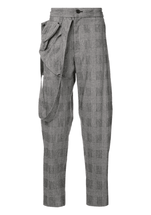 Chalayan check trousers with draped strap on the side - Grey