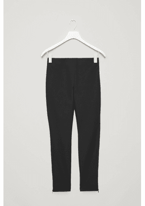 TROUSERS WITH ANKLE ZIPS