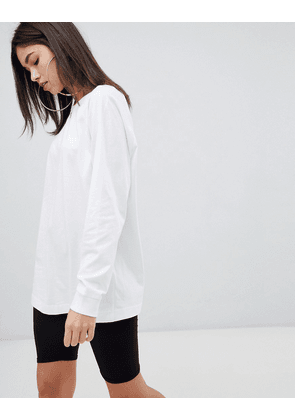 ASOS DESIGN top in super oversized fit with long sleeve in white