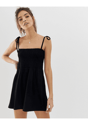 ASOS DESIGN shirred bodice playsuit with tie straps