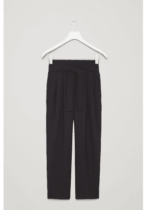 BELTED TROUSERS WITH PLEATS