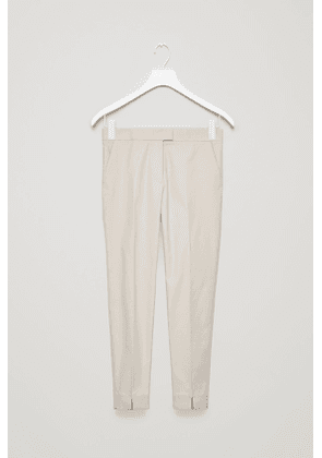 SLIM-FIT TROUSERS WITH PRESS FOLDS