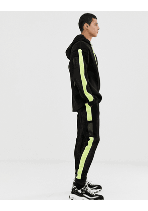ASOS DESIGN co-ord slim joggers in mesh with neon side stripes