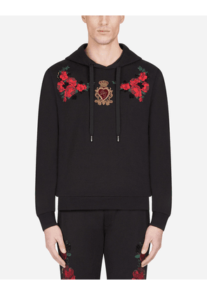 Dolce & Gabbana Sweatshirts - COTTON HOODIE WITH FLORAL PATCH BLACK
