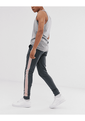 ASOS DESIGN skinny joggers with side stripe in washed black