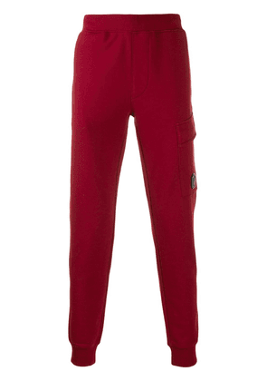 CP Company security tag track pants - Red