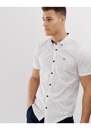 ebe6c5be Hollister icon logo all over geo print short sleeve oxford shirt slim fit in  white