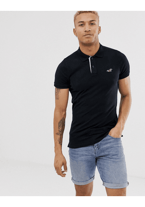 7db6be57 Hollister icon logo modern collar pique polo slim muscle fit in black