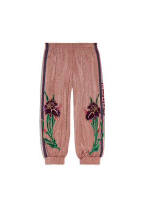 Children's track bottoms with iris appliqués