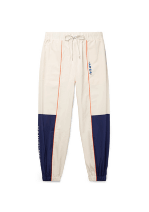 Maison Kitsuné - + Ader Error Tapered Logo-embroidered Piped Shell Track Pants - Off-white