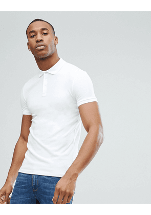 ASOS DESIGN muscle fit pique polo in white