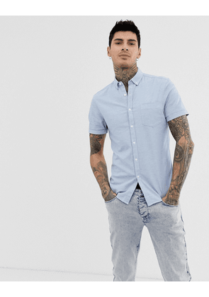 ASOS DESIGN skinny oxford shirt with button down collar in light blue