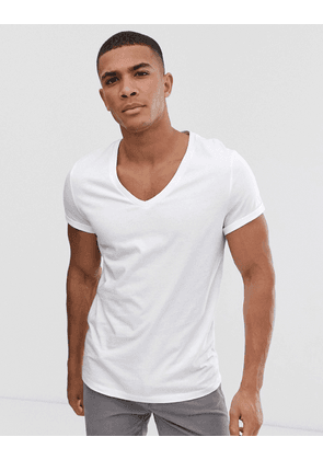 ASOS DESIGN t-shirt with deep v neck and roll sleeve in white