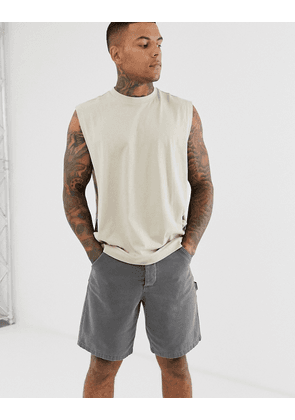 ASOS DESIGN relaxed sleeveless t-shirt with dropped armhole and side split in beige