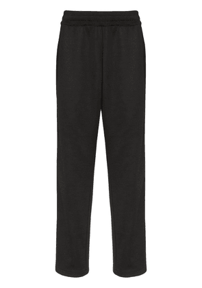 Moschino logo-stripe track trousers - Black