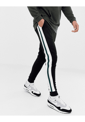 ASOS DESIGN super skinny joggers with side stripes in black