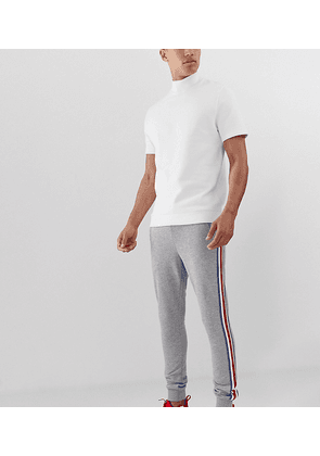 ASOS DESIGN Tall skinny joggers with side stripe taping in grey marl
