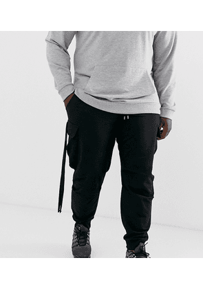ASOS DESIGN Plus tapered joggers with cargo pockets and strapping