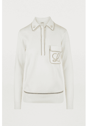 Embroidered polo neck jumper.