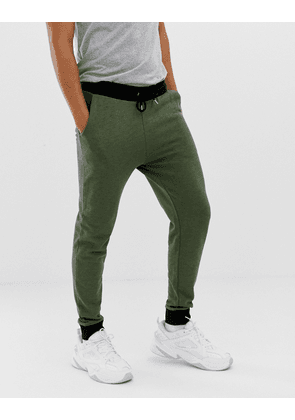 ASOS DESIGN skinny joggers in khaki interest fabric with contrast waistband and cuffs