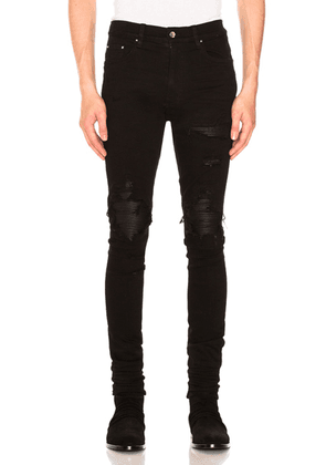 Amiri MX1 Leather Patch Skinny Jeans in Black - Black. Size 28 (also in 29,30,31,32,33,34,36,38).