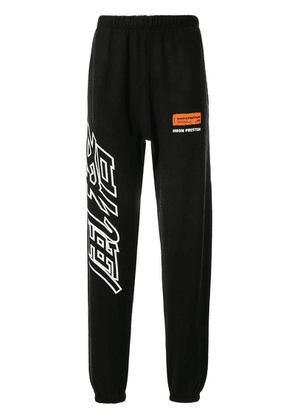 Heron Preston logo print track pants - Black