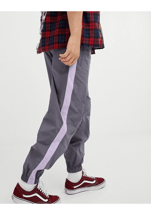 ASOS DESIGN tapered joggers in grey with lilac side tape