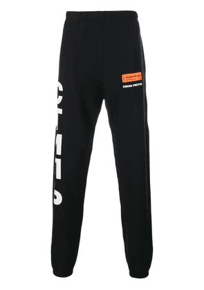 Heron Preston logo printed sweatpants - Black