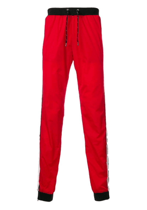 Andrea Crews side-striped track pants - Red
