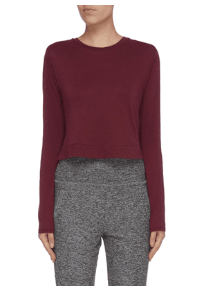 'Back Out' reversible crossover back cropped long sleeve top